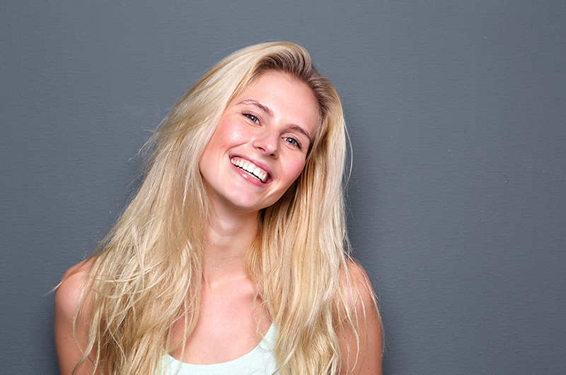 portrait-of-a-cheerful-young-blond-woman-PKW58MY