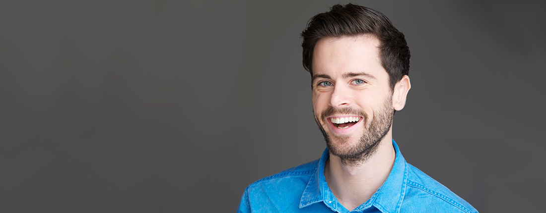 portrait-of-an-attractive-young-man-laughing-PLT8NTE